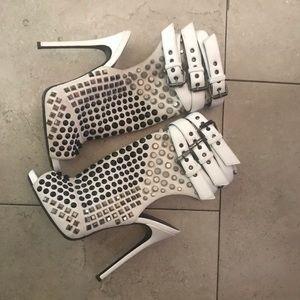Gently worn Guiseppe Zanotti spiked heel toe outs